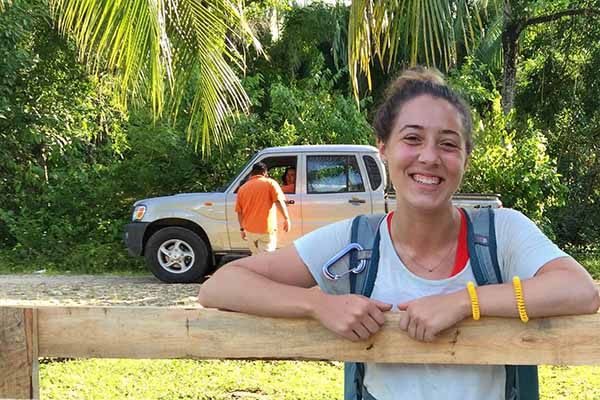 student outside in Belize smiling