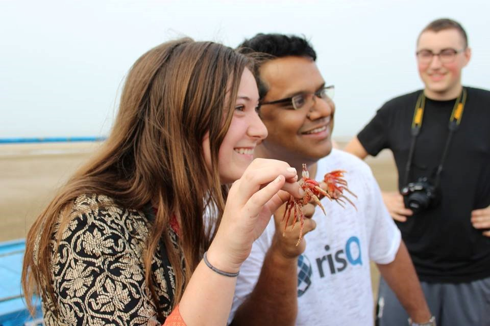 student with professor laughing and eating in India